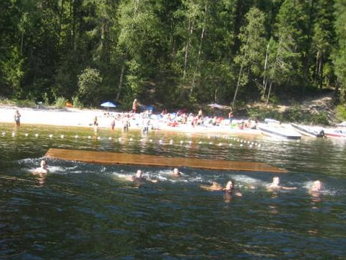 North Barriere Lake Resort swimming area with a dock.
